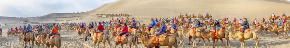 Panorama Of Crowds At Camel Rides, Singing Sand Mountain, Taklamakan Desert, Dunhuang, China Royalty Free Stock Photography