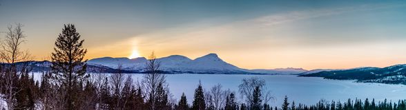 Free Panorama Of Late Evening Sunset In Winter Rossvatnet Lake Mountains In Northern Sweden - Frozen Lake With And And Bjork In The In Royalty Free Stock Image - 162756566