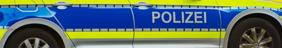 Free Panorama Of The Side Part Of A Police Car In Germany With Warning Varnish In Bright Yellow And Ror With Refection Stripes. Royalty Free Stock Photo - 160300735