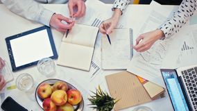 Panorama of Office Desk with Devices and Papers at Business Meeting of Work Team. Top View Panorama of Office Desk with Devices and Papers during Business stock footage