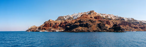 Panorama of Oia town from the sea on Santorini Stock Images