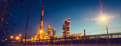 Panorama of Oil refinery industrial plant or factory, storage distillery tanks and steel pipeline, modern petrochemical. Technologies, toned stock photo