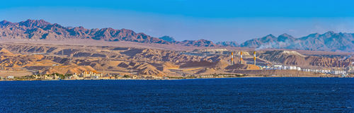 Panorama of oil refinery on Red Sea rocky coast Royalty Free Stock Photo