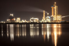 Panorama of Oil refinery with reflection, petrochemical plant Royalty Free Stock Images
