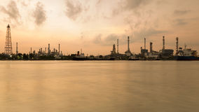 Panorama oil refinery river front Stock Photos