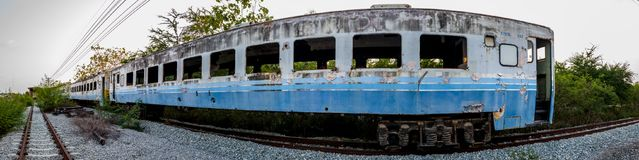 Panorama of old bogey of retired train. Park at the inactive railroad, fish eye style Stock Photos