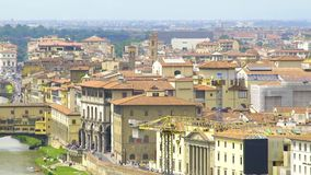 Panorama of old buildings, construction cranes and Vecchio bridge in Florence. Stock footage stock footage