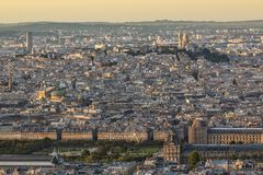 Sacre coeur in Paris at golden sunset. Panorama of old city with great population and density in sunset light royalty free stock image