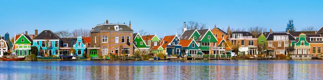 Panorama of old dutch houses, Holland. Panorama with row of old dutch green traditional houses in town Zaanse Schans in Netherlands, Holland near Amsterdam stock photo