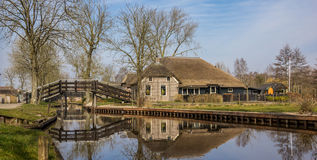 Panorama of an old farm with reflection in the water in Giethoor Stock Photography