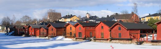 Panorama of the old red barns on the bank of the Porvoonjoki river. Old Porvoo, Finland. Panorama of the old red barns on the bank of the Porvoonjoki river on a stock photo