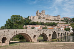 Panorama of old roman bridge and cathedral St Nazaire in Beziers Royalty Free Stock Photo