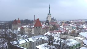 Panorama of old Tallinn on a snowy march day. Estonia. Panorama of old Tallinn on a snowy march day, Estonia stock video footage