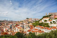 Panorama of the old town in Lisbon at sunny spring day, Portugal. On the hill `Igreja e Convento da Graca` Church Stock Photo