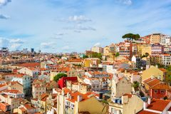 Panorama of the old town in Lisbon in sunny spring day, Portugal. The Mouraria and Graca historical districts.  royalty free stock photos