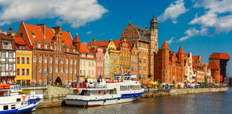 Panorama of Old Town and Motlawa in Gdansk, Poland. Panorama of Old Town with Old harbour crane and city gate Zuraw, Dlugie Pobrzeze and Motlawa River, Gdansk stock photo