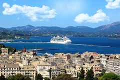 Panorama of the old town. Old town and sea view. White sea liner in the sea bay. Ionian sea Royalty Free Stock Photography
