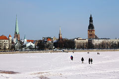 Panorama of Old Town from the snow-bound river Daugava. Royalty Free Stock Photos