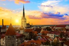 Panorama of old town of Tallinn, Etonia. Tallinn city wall and a view of the Church of St. Olaf. The skyline of the old town, suns. Et royalty free stock photos