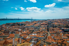 Panorama of old traditional city of Lisbon with red roofs. Stock Image