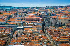 Panorama of old traditional city of Lisbon with red roofs. Stock Images