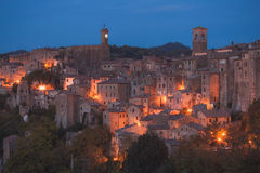 Panorama of old tuff town Sorano at night. Tuscany. Italy Royalty Free Stock Photo