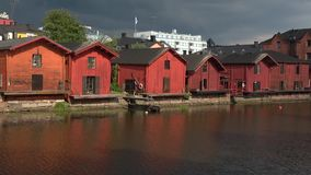Panorama of old wooden barns on the river bank before the storm. Old Porvoo stock footage