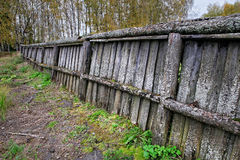 Panorama of an old wooden fence covered Stock Photo