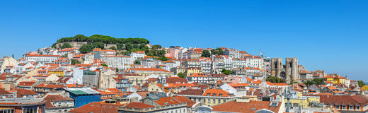 Panorama of the oldest part of Lisbon showing. Alfama, Mouraria and Castelo districts and the Sao Jorge Castle and Lisbon Cathedral Se. Lisbon, Portugal royalty free stock images