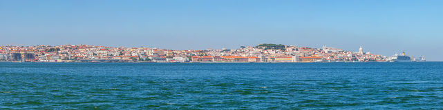 Panorama of the oldest part of Lisbon. Showing Alfama, Mouraria and Castelo districts and the Sao Jorge Castle and Lisbon Cathedral Se. Lisbon, Portugal royalty free stock image