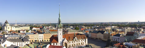 Panorama of Olomouc city's Upper square and the Astronomical clock on Olomouc Town Hall Royalty Free Stock Photo
