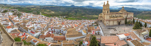Panorama Olvera Cadiz. Panorama of Olvera and Cathedral seen from the Castle of the famous village de la Ruta de los Pueblos Blancos, white villages, between Royalty Free Stock Photos