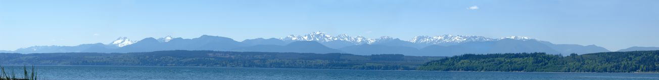 Panorama of the Olympic Mountains as viewed from the Hood Canal. Panorama view of the Olympic Mountain skyline as seen from the Hood Canal stock photography
