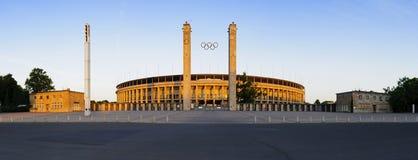 Panorama olympic stadium berlin. Panorama with front entrance of olympic stadium (olympiastadion) in berlin, germany, at sunrise Royalty Free Stock Image