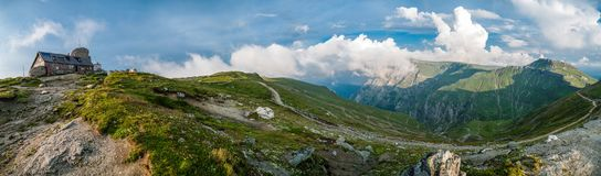 Panorama at Omu Peak. (2507 meters). Omu Chalet (far left), the path to the peak and Costila Peak hidden in the clouds at the horizon Stock Photography