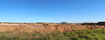 Panorama of open cut mineral sands mining at Dardanup Western Australia. The Panorama of open cut mineral sands mining at Dardanup Western Australia displays Stock Photos