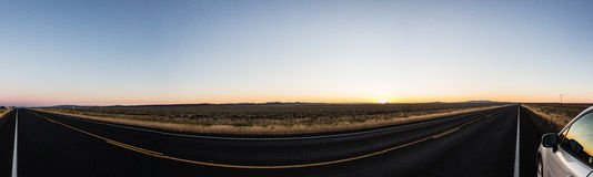 Panorama of the open road in Eastern Oregon. With car in corner Royalty Free Stock Images