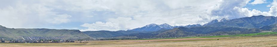 Panorama of Oquirrh Mountain range which includes The Bingham Canyon Mine or Kennecott Copper Mine, rumored the largest open pit c. Opper mine in the world in Stock Images