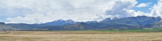 Panorama of Oquirrh Mountain range which includes The Bingham Canyon Mine or Kennecott Copper Mine, rumored the largest open pit c. Opper mine in the world in Royalty Free Stock Photo