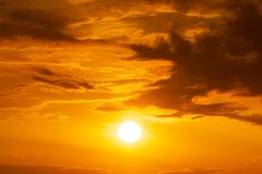 Panorama of orange sky and sun background sunrise or sunset scene. Panorama of brightly yellow sun on the orange sky with clouds at golden hour natue background stock photography