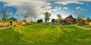 Panorama outside vacation wooden village home in sunny evening day . Full 360 degree seamless panorama in equirectangular stock images