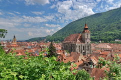 Landmark attraction in Brasov, Romania. Panorama over the old town with the imposing catholic Black Church (Biserica. Neagra) in center Stock Images