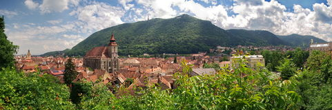 Landmark attraction in Brasov, Romania. Panorama of the city Brasov, old town. Catholic Black Church (Biserica Neagra) Stock Photos