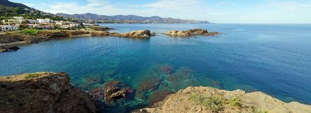 Panorama over Costa Brava and its blue waters. Coastal panorama over blue waters of the Mediterranean sea in Llanca, Costa Brava, Catalonia, Spain Royalty Free Stock Photography