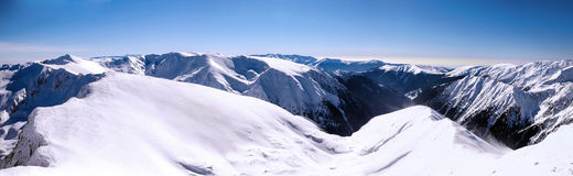 Panorama over mountain ridges in winter Royalty Free Stock Photos