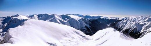 Panorama over mountain ridges in winter. Panoramic view over mountain ridges in winter. stitched images Royalty Free Stock Photos