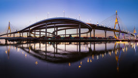 Panorama over Twin suspension bridge and water reflection during twilight, Bangkok Thailand Stock Images