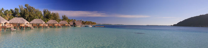 Panorama of over water bungalows in Bora Bora. Over water bungalows in Bora Bora ( French Polynesia - society islands ) at the Pearl Beach Resort and Spa Stock Image