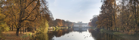 Panorama of Palace Over Water in Lazienki park, Warsaw, Poland Royalty Free Stock Photos