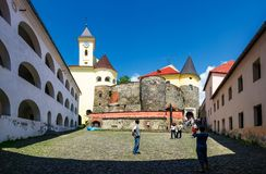 Panorama of Palanok Castle courtyard. Mukachevo, Ukraine - MAY 25, 2008: panorama of Palanok Castle courtyard with clock tower. Old fortification now serves as stock image